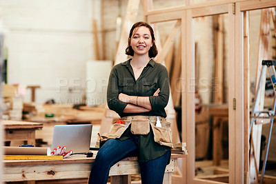 Buy stock photo Cropped shot of a young female carpenter smiling at the camera