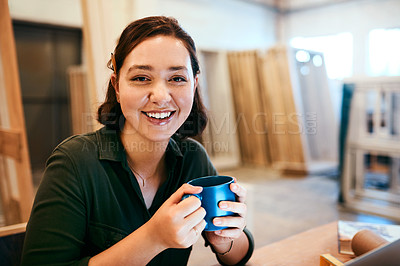 Buy stock photo Cropped shot of a female carpenter sitting at her desk in a workshop