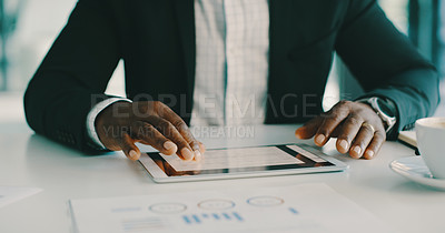 Buy stock photo Cropped shot of an unrecognizable businessman using a digital tablet while working inside his office during the day