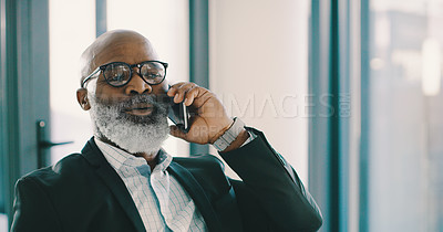 Buy stock photo Shot of a mature businessman making a phone call inside his office