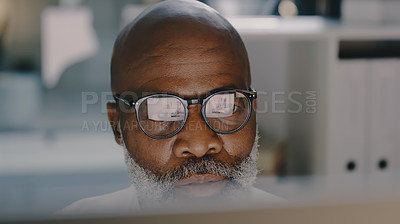 Buy stock photo Shot of a mature businessman working on computer inside his office during the day
