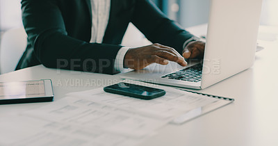Buy stock photo Cropped shot of an unrecognizable businessman working on a laptop inside his office
