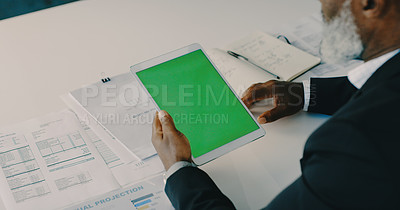 Buy stock photo Cropped shot of an unrecognizable mature businessman using a digital tablet inside his  office