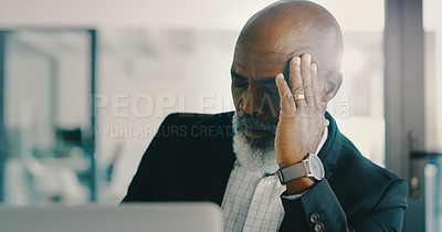 Buy stock photo Shot of a mature businessman feeling stressed out and suffering from a headache while working inside his office