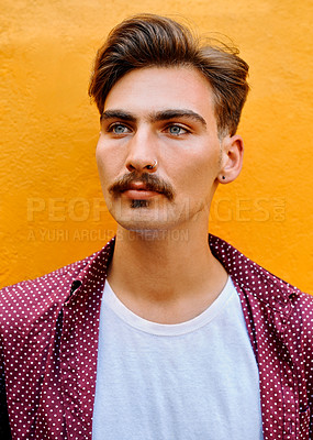 Buy stock photo Cropped shot of a handsome young man standing against a yellow background after getting a fresh haircut in a salon