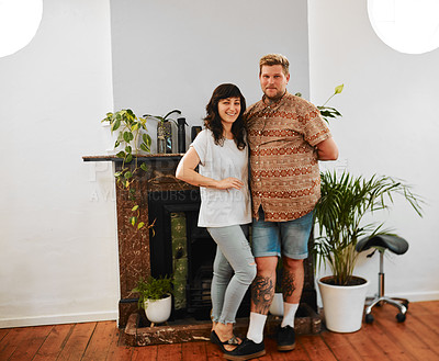 Buy stock photo Full length portrait of a happy young couple standing arm in arm together in their salon