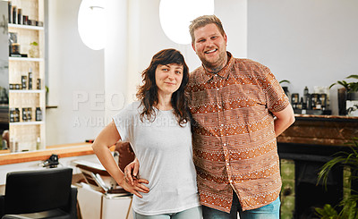 Buy stock photo Cropped portrait of a happy young couple standing arm in arm together in their salon