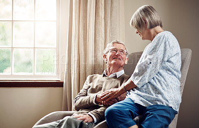 Buy stock photo Shot of a senior couple sharing an affectionate moment at home
