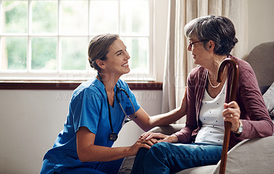 Buy stock photo Shot of a senior woman being cared for by a young nurse at home