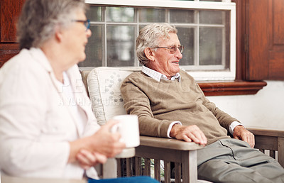 Buy stock photo Cropped shot of a group of senior citizens sitting together and enjoying a day out on the veranda