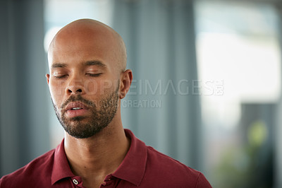 Buy stock photo Cropped shot of a young businessman standing with his eyes closed