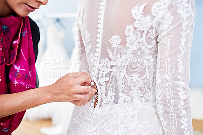 Buy stock photo Cropped shot of an unrecognizable bridal shop assistant helping a customer with fitting her wedding gown