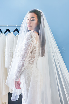 Buy stock photo Cropped shot of a beautiful young bride fitting her wedding gown in a bridal shop