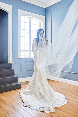 Buy stock photo Rearview shot of an unrecognizable bride wearing her wedding gown in her dressing room
