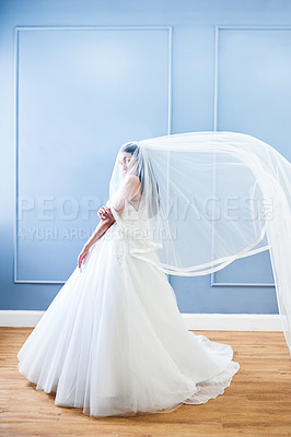 Buy stock photo Full length portrait of a beautiful young bride wearing her wedding gown in her dressing room