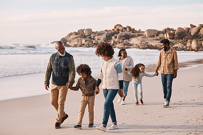 Buy stock photo Shot of an adorable little boy and girl having a fun day at the beach with their parents and grandparents