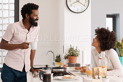 Buy stock photo Cropped shot of a couple having breakfast in their kitchen