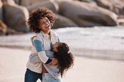 Buy stock photo Shot of an adorable little girl having a fun day at the beach with her mother