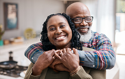 Buy stock photo Portrait of a mature couple spending quality time together at home