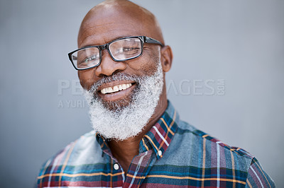 Buy stock photo Portrait of a mature man standing against a grey background