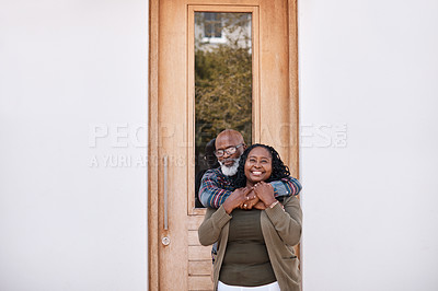 Buy stock photo Portrait of a mature couple standing outside their home