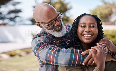 Buy stock photo Portrait of a mature woman spending quality time with her husband outdoors