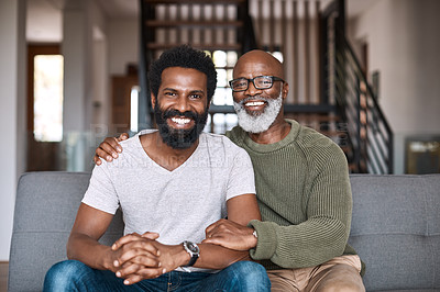Buy stock photo Portrait of a happy young man relaxing and spending time with his father at home