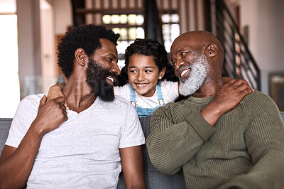 Buy stock photo Shot of an adorable little girl spending time with her father and grandfather at home
