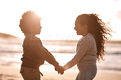 Buy stock photo Shot of an adorable little boy and girl having fun together at the beach