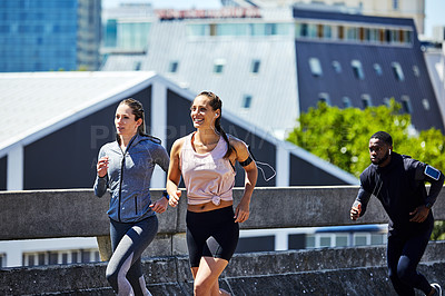 Buy stock photo Cropped shot of two young women out for a run in the city