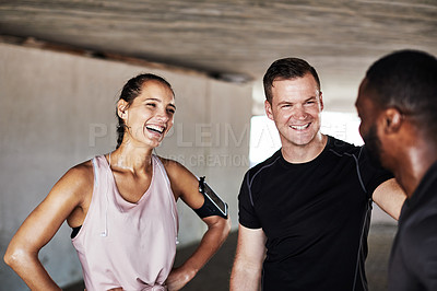 Buy stock photo Cropped shot of three young athletes talking while working out in the city
