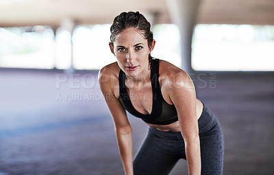 Buy stock photo Cropped portrait of an attractive young female athlete resting during her workout in the city
