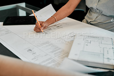 Buy stock photo Cropped shot of an unrecognizable architect working on blueprints