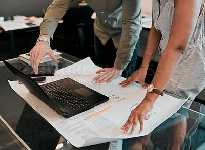 Buy stock photo Cropped shot of two unrecognizable architects working together in a modern office