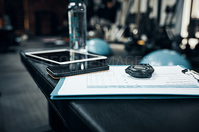 Buy stock photo Cropped shot of items lying on bench in a gym