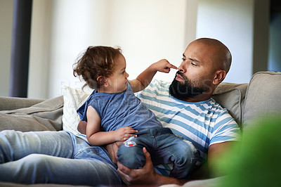 Buy stock photo Cropped shot of an affectionate young single father spending time with his little son in their living room at home