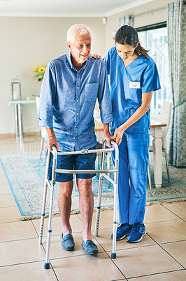 Buy stock photo Full length shot of an attractive young female physiotherapist assisting a senior man to walk using a walker in a modern clinic