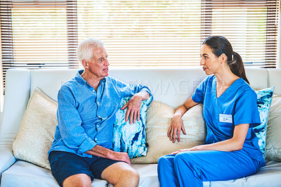 Buy stock photo Cropped shot of an attractive young female doctor having a discussion with a senior man in his home