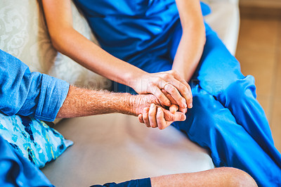 Buy stock photo Cropped shot of an unrecognizable female doctor consoling a senior man during a consultation in his home