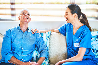 Buy stock photo Cropped shot of a senior man having a laugh with his doctor during a consultation in his home