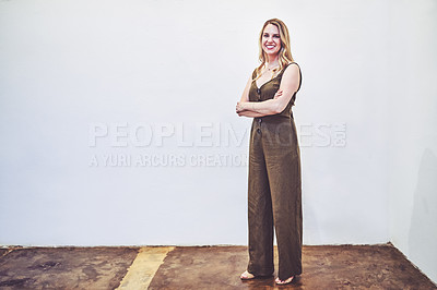Buy stock photo Portrait of a young businesswoman standing against a white background