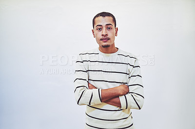 Buy stock photo Studio portrait of a young businessman standing against a white background