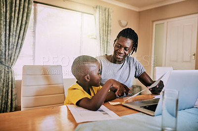 Buy stock photo Cropped shot of an affectionate young single father showing his son some paperwork while doing their household budget at home