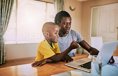 Buy stock photo Cropped shot of an affectionate young single father using a laptop with his son at home