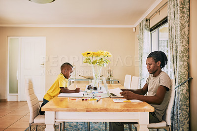 Buy stock photo Cropped shot of a  young single father doing his household budget while his son is doing his homework at home