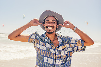 Buy stock photo Cropped shot of a young man spending the day at the beach