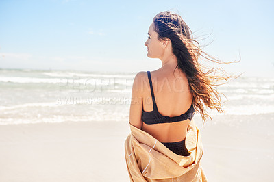 Buy stock photo Shot of a beautiful young woman spending the day at the beach