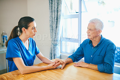 Buy stock photo Cropped shot of an attractive young female nurse consoling a senior man in a nursing home