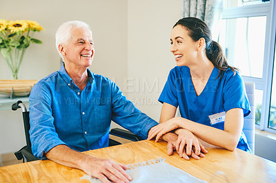 Buy stock photo Cropped shot of an attractive young female nurse laughing with a senior man at a nursing home