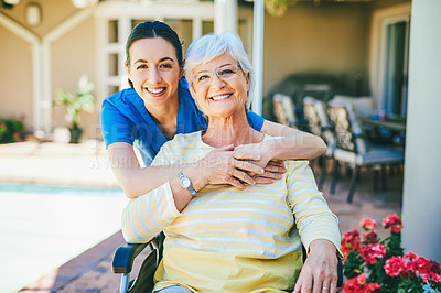 Buy stock photo Cropped portrait of an attractive young female nurse embracing a senior woman outdoors at a nursing home